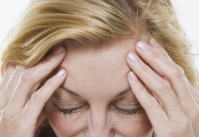 Woman with Headache --- Image by © Royalty-Free/Corbis