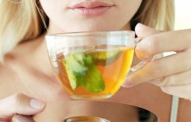 Picture of woman drinking herbal tea (green tea) from Alamy