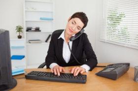 Active secretary answering the phone