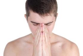 Prayer. Young man shirtless  praying.