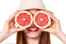 girl-covering-eyes-two-halfs-grapefruit-citrus-fruit-woman-attractive-long-hair-holding-fruits-slices-her-white-85641661