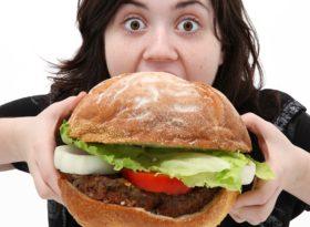 woman-eating-hamburger